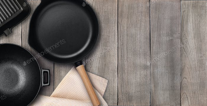 Empty cast iron frying pan. Top view with copy space