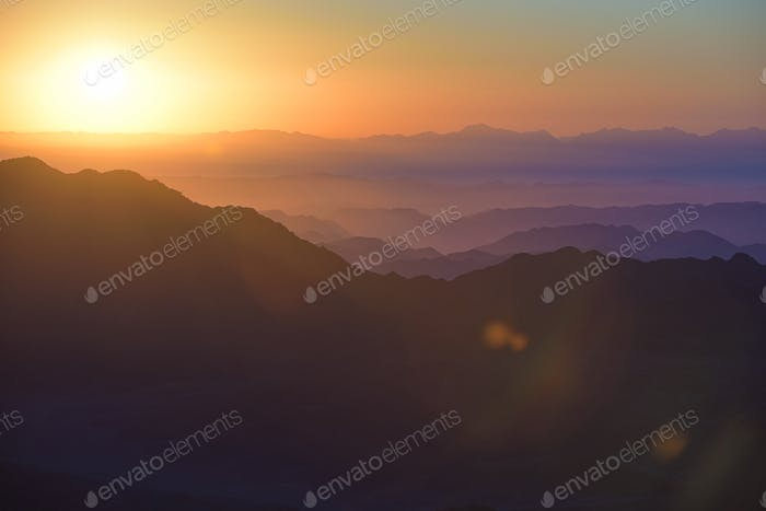 Colorful sunrise in mountains.