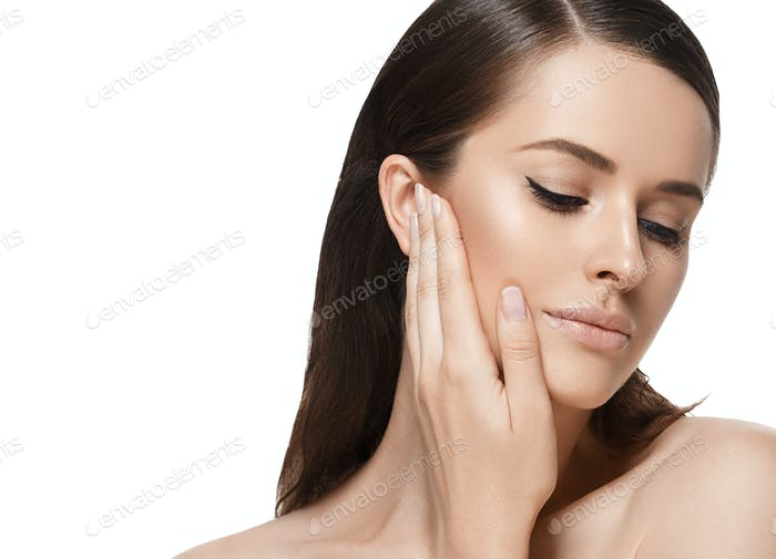 Beautiful woman with hand touching healthy beauty skin