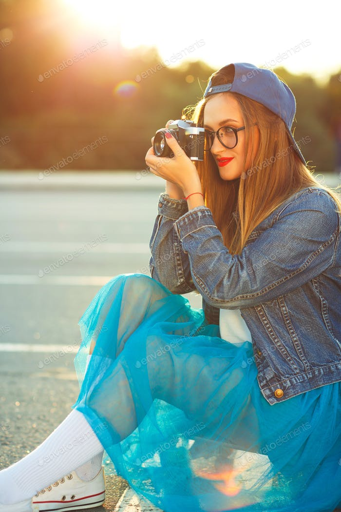 Hipster girl with old camera
