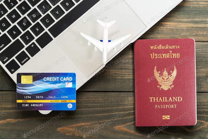 Passport with credit card on laptop-2