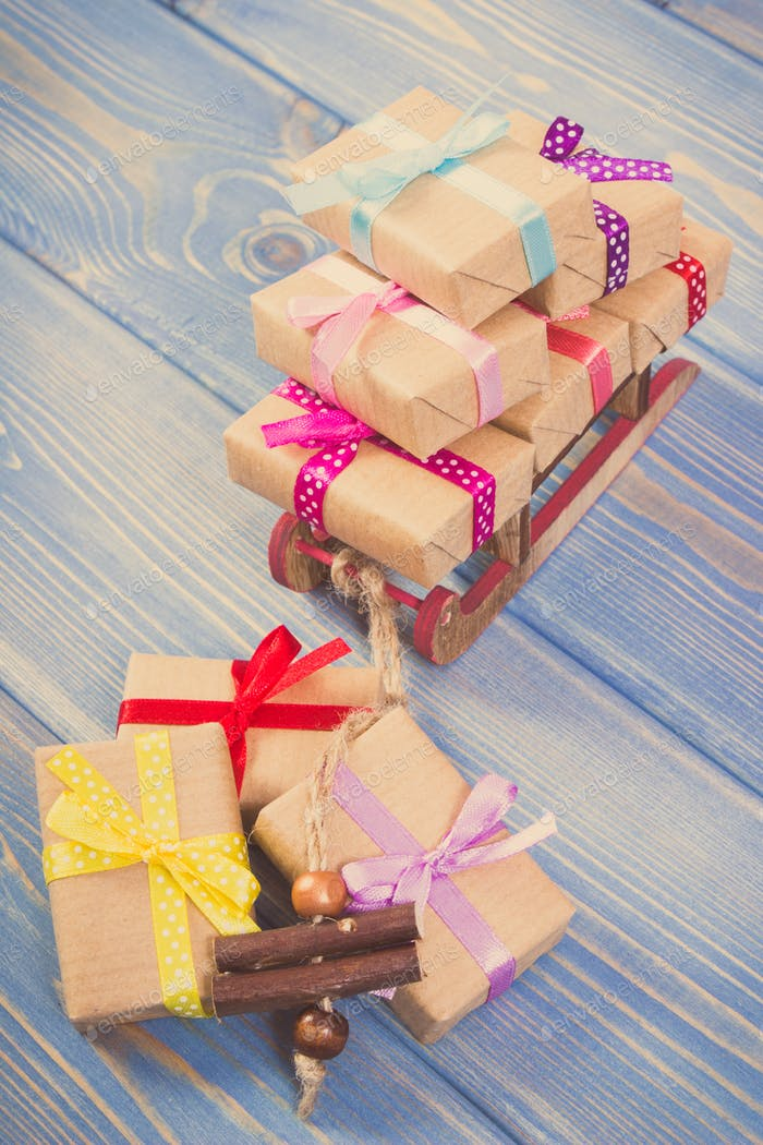 Vintage photo, Wooden sled and wrapped gifts with ribbons for Christmas or other celebration