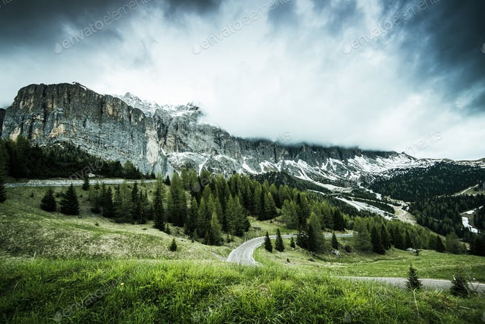 Gardena pass in Italian Alps at dramatic cloudy weather