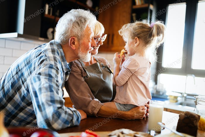 Grandparents playing and having fun with their granddaughter