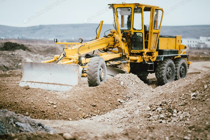 highway construction site with motor grader, excavator and bulldozer working