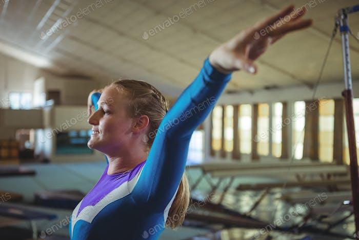 Female gymnast practicing gymnastics