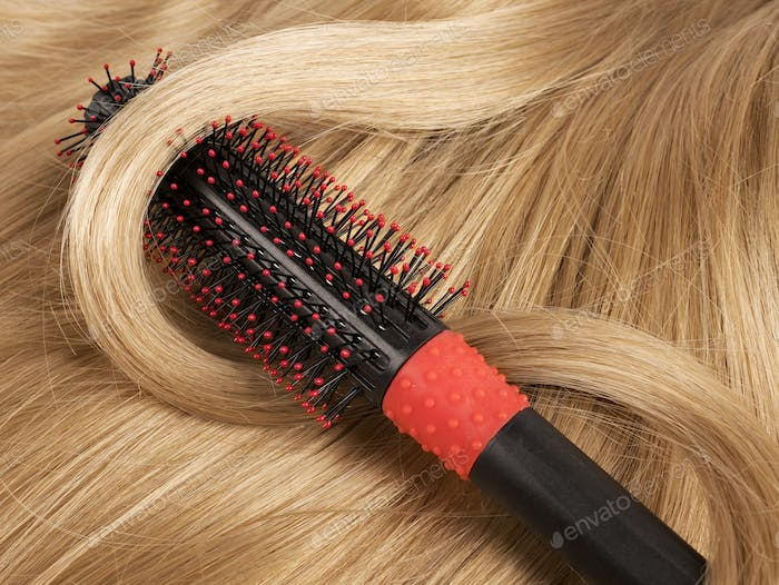 Long blond human hair with a comb