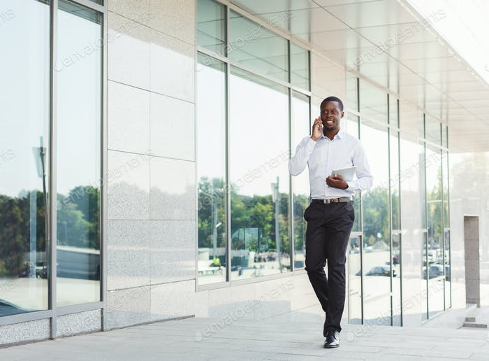 Black businessman outdoors in smart casual ware