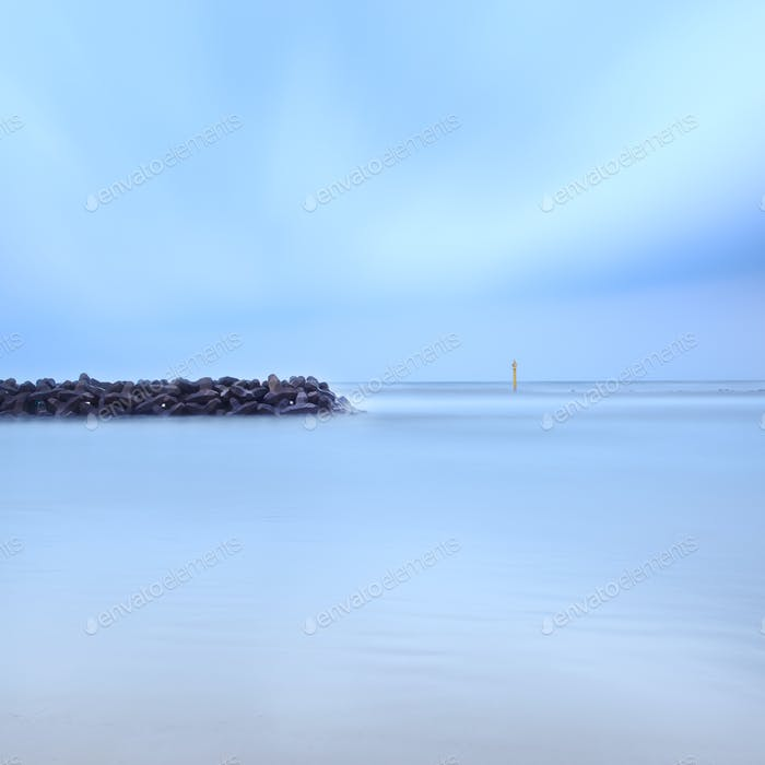 Tetrapods breakwater concrete structure protection seascape long exposure photography