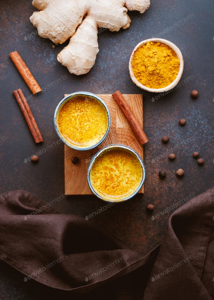 Top view of turmeric latte which is made from curcuma, ginger, cinnamon and allspice