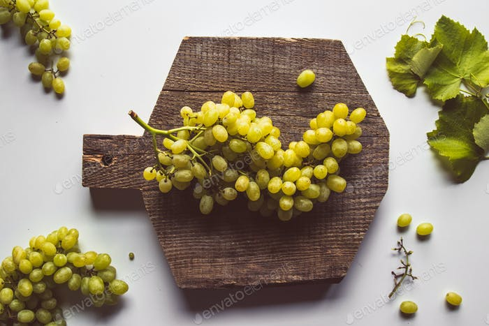 fresh grape on cutting board