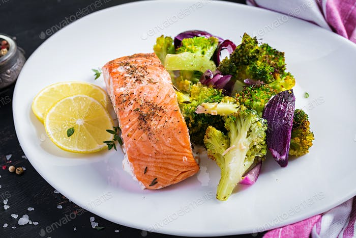 Baked salmon fillet with broccoli, red onion and lemon.