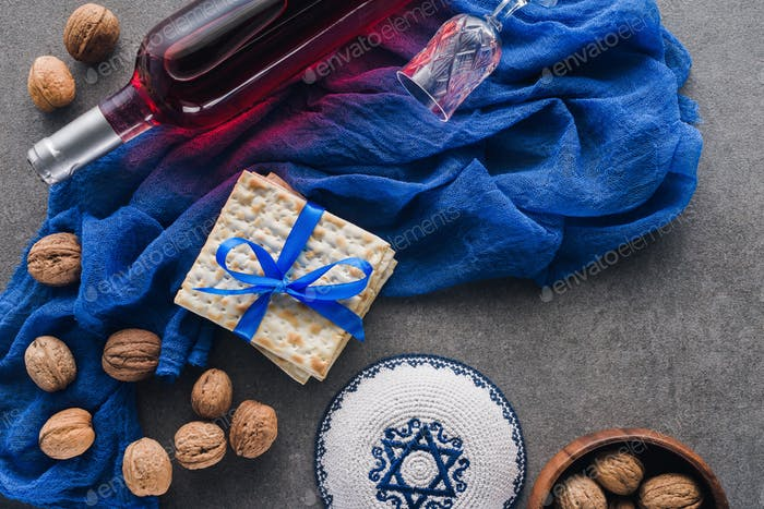 top view of matza, kippah and wine, jewish Passover holiday concept