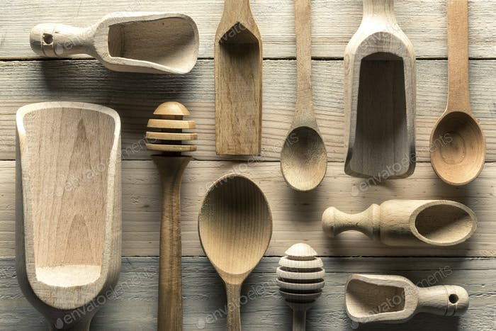Different wooden utensils on wooden table