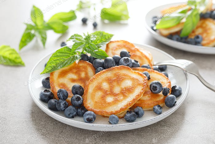 Fritters, pancakes with fresh blueberry