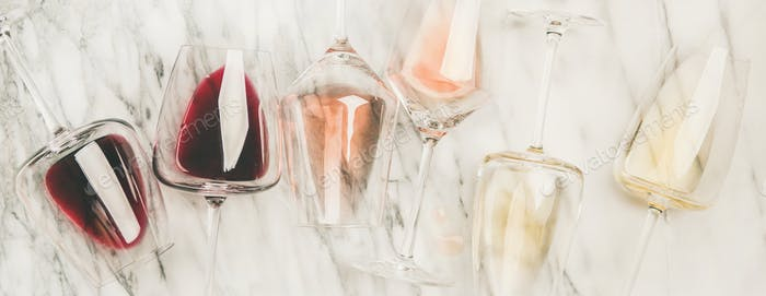 Red, rose, white wine in glasses and corkscrews, wide composition