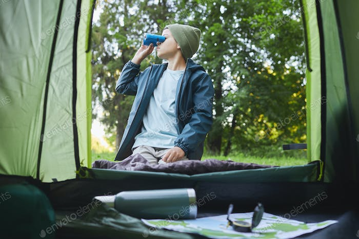 Teenage Boy by Camping Tent