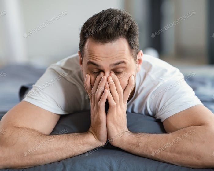 Sleepy Man Rubbing Eyes Waking Up Lying In Bed Indoor