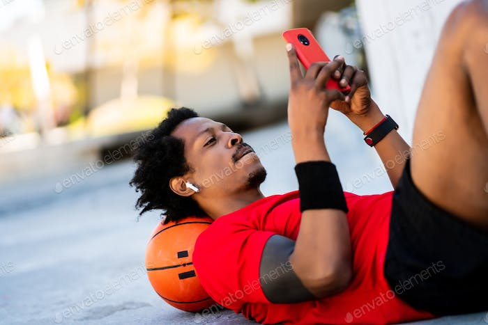 Athlete man using his mobile phone.