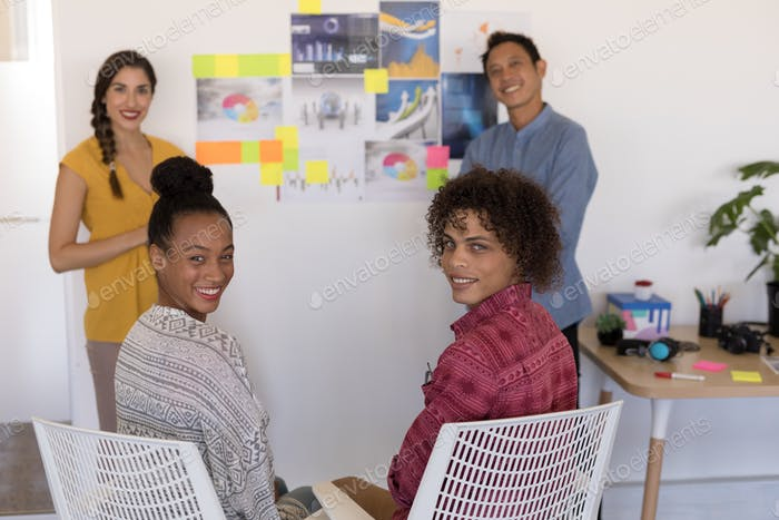 Portrait of diverse casually dressed business colleagues smiling together in office