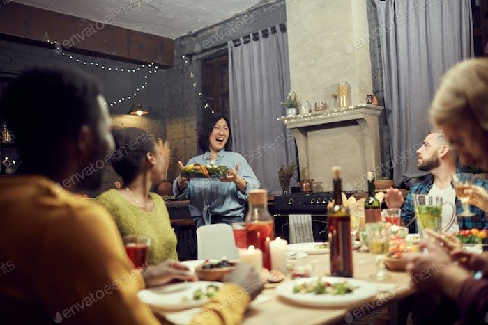 Young Hostess Bringing Main Dish