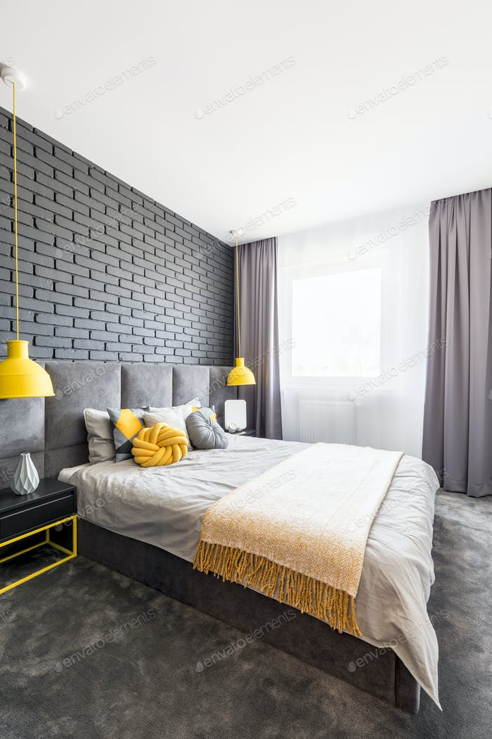Gray and yellow bedroom interior