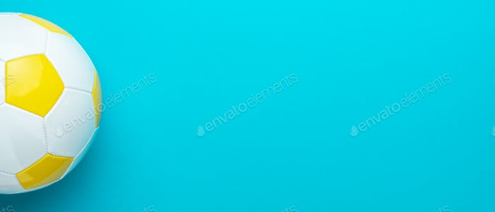 Minimalist Photo Of Soccer Ball Over Turquoise Blue Background With Copy Space