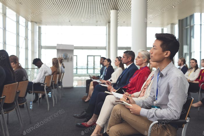 Business people listening attentively in office building