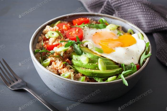 quinoa bowl with fried egg, avocado, tomato, rocket. Healthy veg