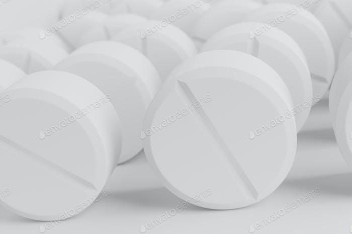 Haufen von runder Form medizinische Pille auf weißem Hintergrund.