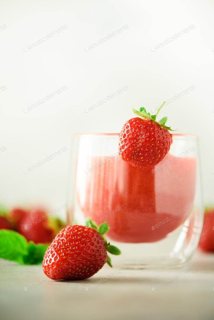 Healthy strawberry smoothie in glass on gray background with copy space. Banner. Summer food and