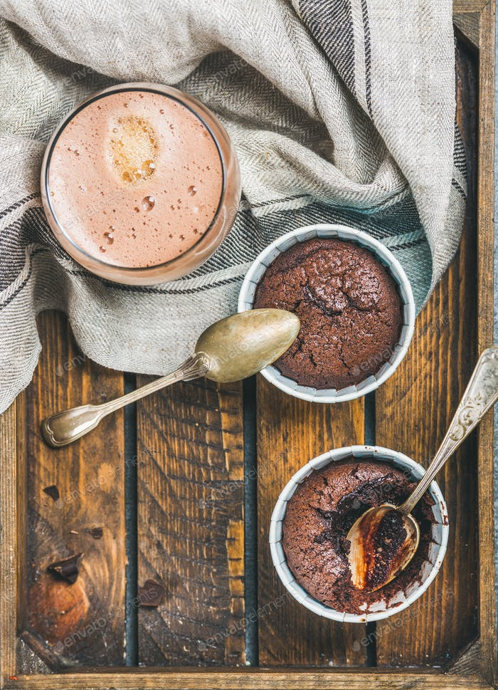 Chocolate souffle in baking cups and mocha coffee, copy space