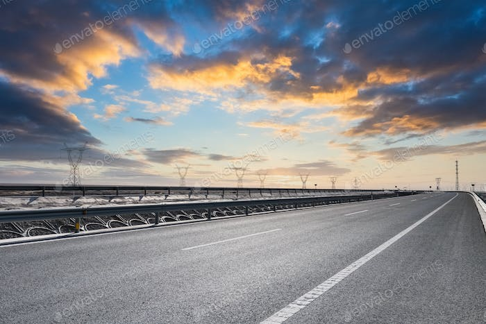 freeway against the sunset glow