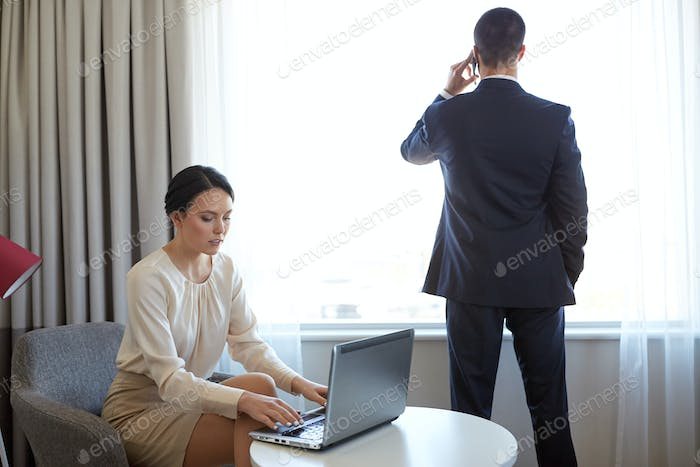 business team with laptop working at hotel room