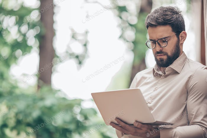 Working young man with laptop