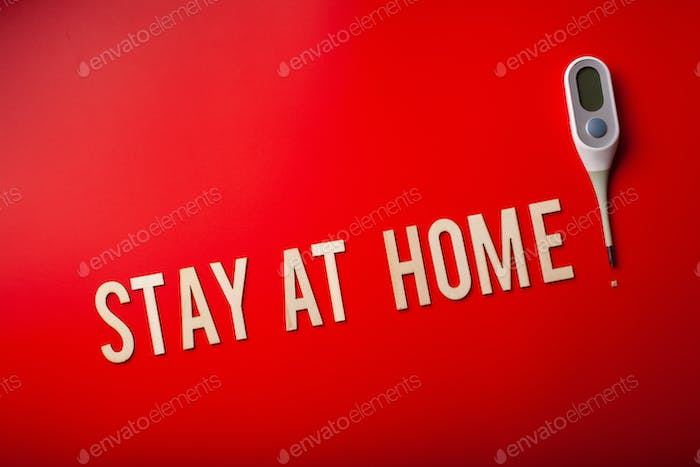 stay at home word text wooden letter on red background coronavirus covid-19