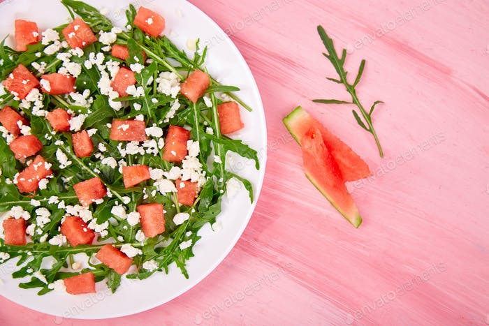 Fresh summer watermelon salad with feta cheese and arugula