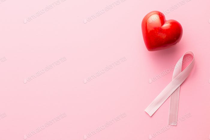 Pink breast cancer ribbon and heart.