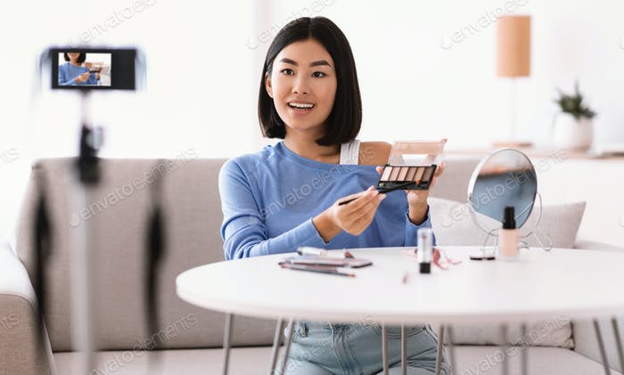 Asian Woman Doing Makeup, Recording Her Beauty Blog