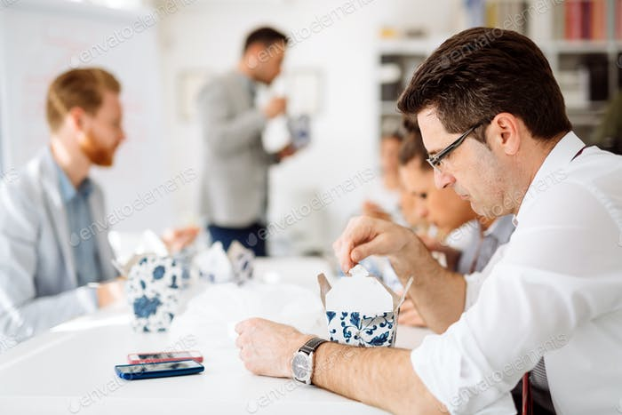 Business people eating in office