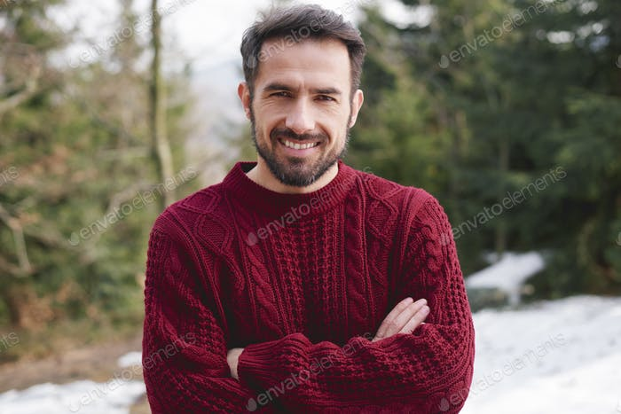 Portrait of smiling man in the forest