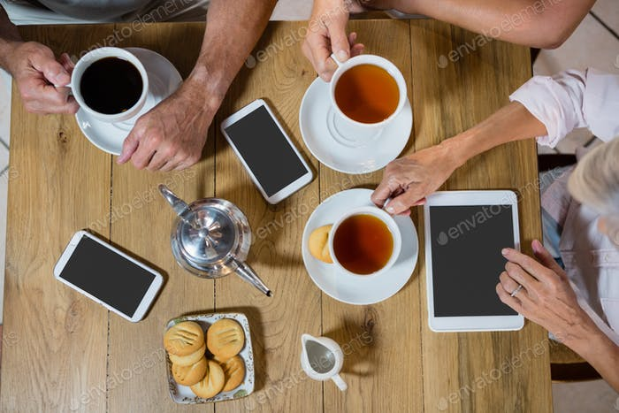 Group of senior friends having coffee