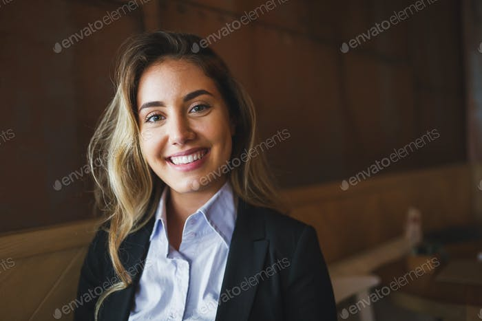 Beautiful blond business woman in shirt