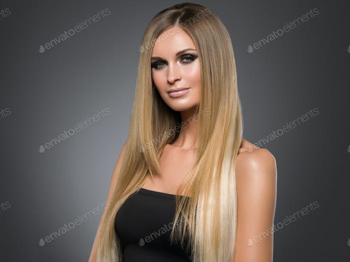 Thumbnail for Hair beautiful long blond hairstyle woman fashion makeup healthy skin and hair black background