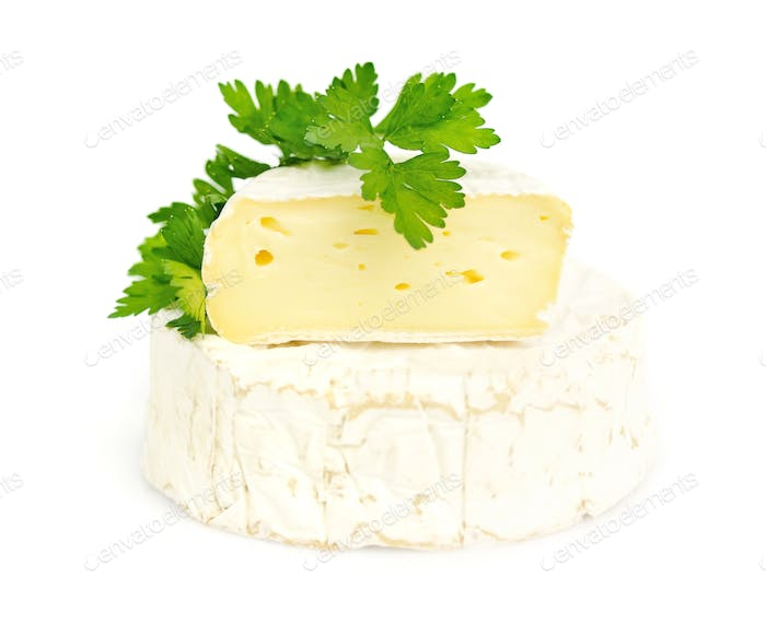 Camembert cheese with a parsley isolated on white