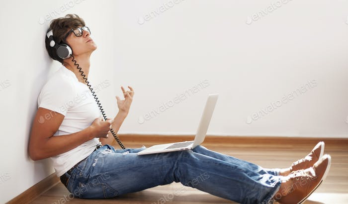 Hipster man playing air guitar
