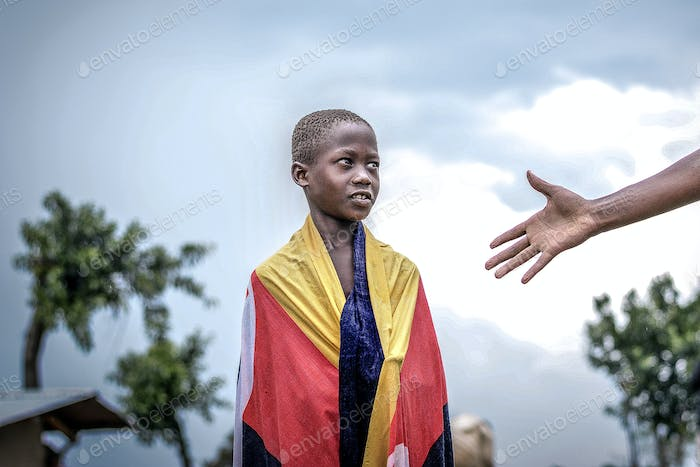 African Boy  looking at a raised Hand