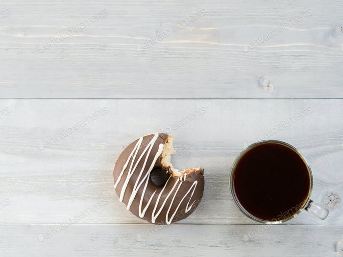 donuts on gray wooden background, copy space, top view