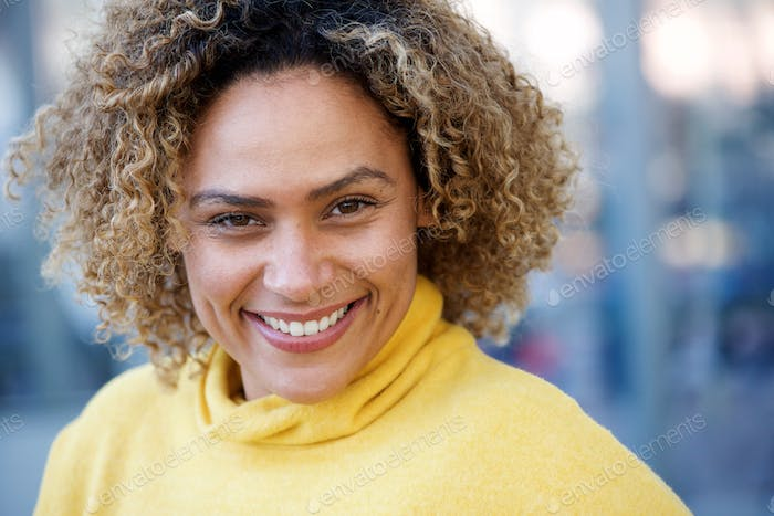 Close up happy african american woman with curly hair