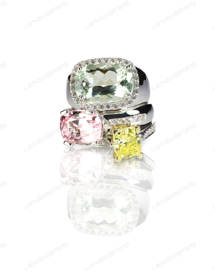 Grouping of colored gemstone diamond rings stacked